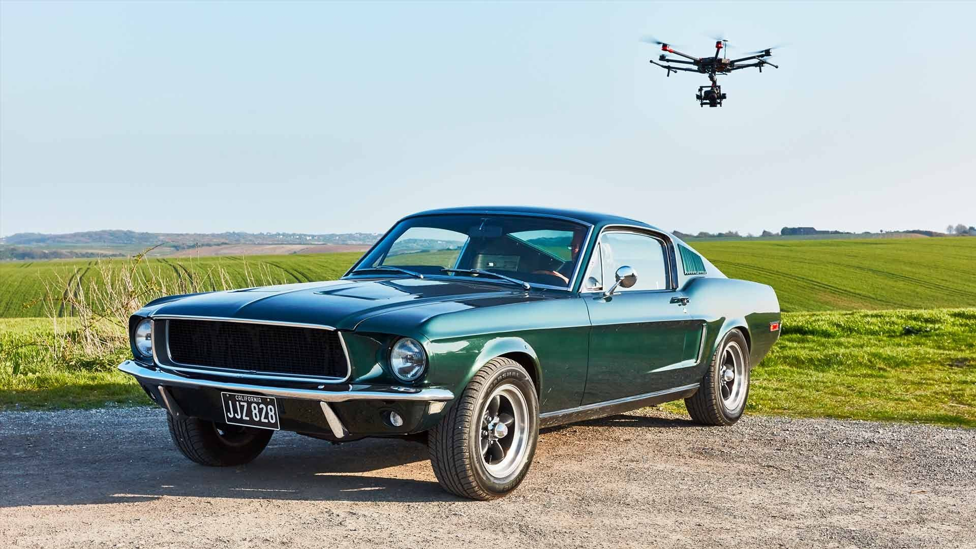 Drone flying over a vintage car